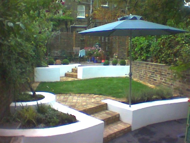 Finished garden view with garden umbrella.