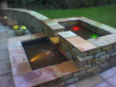 water feature with underwater lights from viewed from the side.